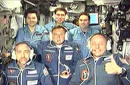 Millionaut Richard Garriott aboard the International Space Station with five other lesser known professional space travelers.