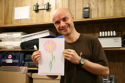 Mars500 crew member Cyrille Fournier shows a flower he drew for his girlfriend.