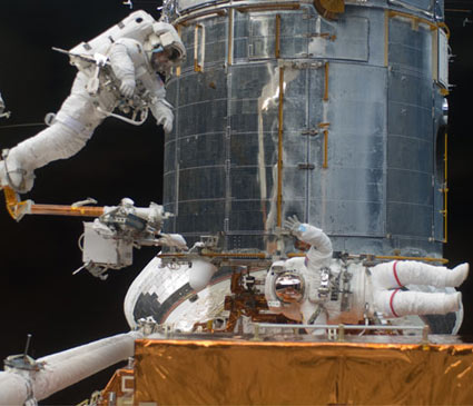 Spacewalkers Drew Feustel (left) and John Grunsfeld participate in the third Hubble repair spacewalk of STS-125. Photo Credit: NASA