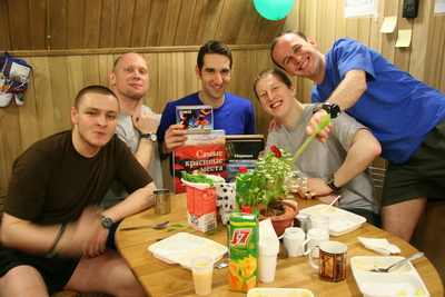 The Mars500 crew helps ESA-selected crewmember Oliver Knickel celebrate his 29th birthday inside the isolation facility in Moscow, Russia. Credits: ESA