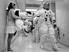 Headed for the launch pad, Apollo 10 commander Tom Stafford pats the nose of a stuffed Snoopy held by Jamye Flowers (Coplin), astronaut Gordon Cooper's secretary. Photo Credit: NASA