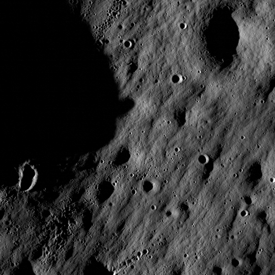 These images show cratered regions near the moon's Mare Nubium region, as photographed by the Lunar Reconnaissance Orbiter's LROC instrument. Impact craters feature prominently in both images. Older craters have softened edges, while younger craters appear crisp. Each image shows a region 1,400 meters (0.87 miles) wide, and features as small as 3 meters (9.8 feet) wide can be discerned. The bottoms of both images face lunar north.