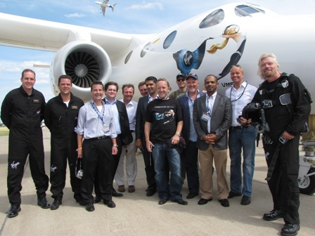 Sir Richard Branson with Virgin Galactic pilots, staffers and investors. To his right is Mohamed Badawy Al-Husseiny, CEO of Aabar, which made a $280 million in Virgin Galactic.