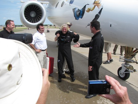 Richard Branson after getting drenched by some Virgin Galactic staffers.