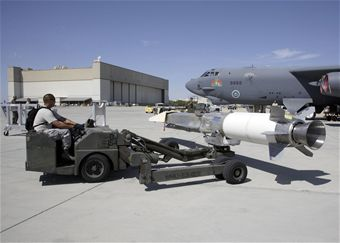 On the flightline of Edwards Air Force Base, Calif., Staff Sgt. Jonathan Young prepares to upload the X-51A WaveRider hypersonic flight test vehicle to a B-52 Stratofortress July 17 for fit testing. Two B-52 test flights are planned this fall prior to the X-51's first hypersonic scramjet flight over the Pacific Ocean scheduled in December. Representatives from the Air Force Research Laboratory, DARPA, Pratt & Whitney Rocketdyne and Boeing are partnering on the X-51A technology demonstrator program.