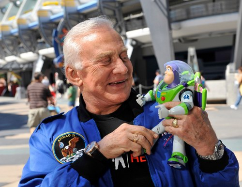 Apollo 11 astronaut Buzz Aldrin poses Oct. 2, 2009 at the Magic Kingdom with the 12-inch-tall Buzz Lightyear toy that spent 15 months in space onboard the International Space Station (ISS). (Credit: Garth Vaughan/Disney)