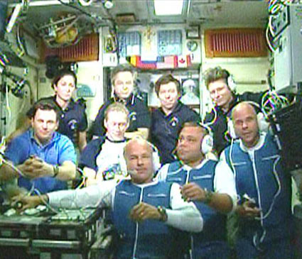 Space tourist Guy Laliberte (front, far right) aboard the International Space Station.