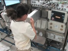Astronaut Shannon Walker activates an NanoRacks experiment aboard the International Space Station. Image credit: NASA