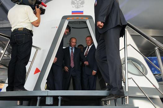 "Vladimir Putin inside of a full-size mockup of Russia's six-passenger ""Rus"" spacecraft. (Credit: RSC Energia)"