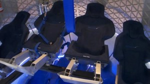 With all seven crewmembers in their seats, Dragon has sufficient interior space for three additional people to stand and assist the crew with their launch preparations. (Credit: SpaceX)