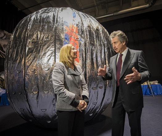 NASA Deputy Administrator Lori Garver and President and founder of Bigelow Aerospace Robert T. Bigelow talk while standing next to the Bigelow Expandable Activity Module (BEAM) during a media briefing where is was announced that the BEAM expandable space habitat technology will be tested on the International Space Station, Wednesday, Jan. 16, 2013 in Las Vegas. BEAM is scheduled to arrive at the space station in 2015 for a two-year technology demonstration. (Credit: NASA/Bill Ingalls)