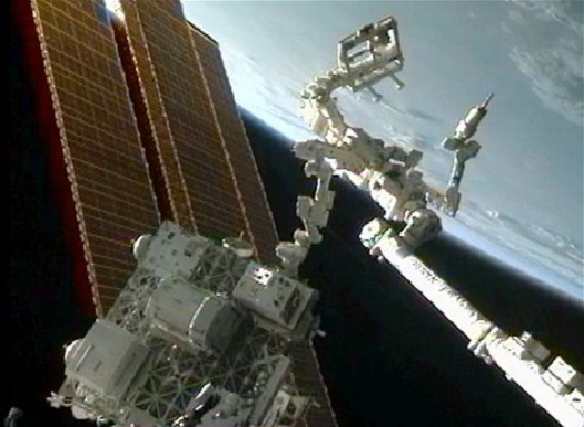 The Robotic Refueling Mission, or RRM, investigation (center, on platform) uses the International Space Station's Canadarm2 and the Canadian Dextre robot (right) to demonstrate satellite-servicing tasks. (Credit: NASA/CSA)