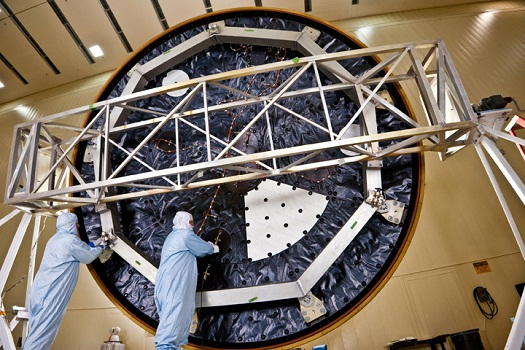 Technicians at Lockheed Martin Space Systems, Denver, prepare the heat shield for NASA's Mars Science Laboratory (MSL), critical hardware to place the Curiosity rover on the red planet last August. This view shows the inner surface of the (MSL) heat shield, where technicians are installing electronics of an instrument for collecting data about temperature and pressure during descent through the (Credit: NASA/JPL-Caltech/Lockheed Martin)