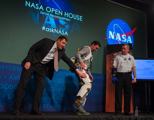 Bill Bluethemann, left, Roger Ronekamp, center, and Jonathan Rogers, all engineers at NASA Johnson Space Center perform a demonstration of NASA's exoskeleton technology during the NASA Open House at NASA Headquarters, Friday, Jan. 18, 2013, in Washington. (Credit: Paul E. Alers, NASA)