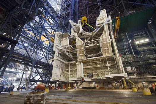 As part of Ground Systems Development and Operations Program work at Kennedy Space Center, space shuttle-era work platforms are removed from high bay 3 in the Vehicle Assembly Building on Oct. 24. All platforms were removed two days later. (Credit: NASA/Jim Grossmann)