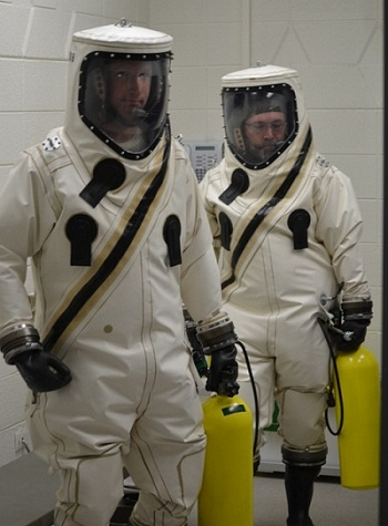 Orbital Propulsion Team members in SCAPE suits. (Credit: Orbital Sciences Corporation)