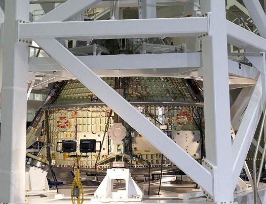 The Orion crew module is secured on the static load test fixture in preparation for a series of tests that will simulate the massive loads the spacecraft would experience during its mission. (Credit: NASA/Kim Shiflett)