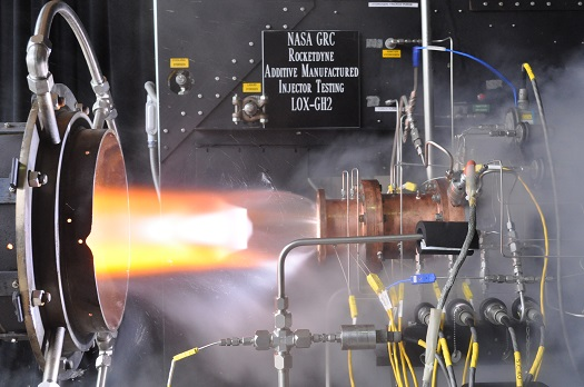 Liquid oxygen/gaseous hydrogen rocket injector assembly built using additive manufacturing technology is hot-fire tested at NASA Glenn Research Center's Rocket Combustion Laboratory in Cleveland. (Credit:  NASA Glenn Research Center)