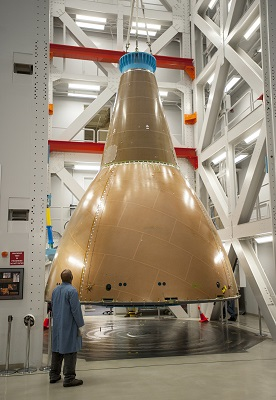 NASA engineers and contractors conduct static loads testing of the Orion Launch Abort System (LAS) Fairing Assembly, flight hardware that will be used to cover and protect the Orion crew module during Exploration Flight Test-1 (EFT-1), scheduled for September 2014. (Credit:  Lockheed Martin)