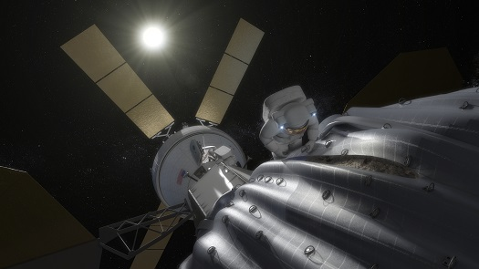 This concept image shows an astronaut preparing to take samples from the captured asteroid after it has been relocated to a stable orbit in the Earth-moon system. Hundreds of rings are affixed to the asteroid capture bag, helping the astronaut carefully navigate the surface. (Credit: NASA)