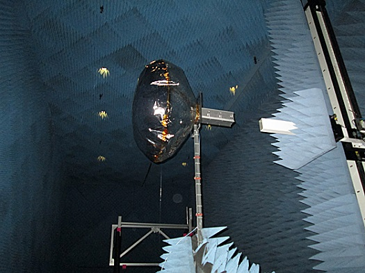 View of a CubeSat equipped with an inflated antenna, in a NASA radiation chamber. (Credit: Alessandra Babuscia)