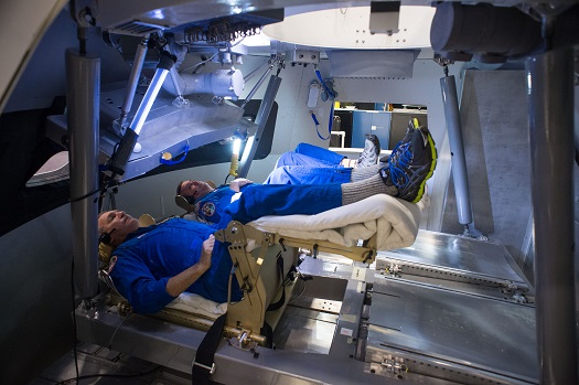Astronauts Rick Linnehan and Mike Foreman try out a prototype display and control system inside an Orion spacecraft mockup at Johnson Space Center during the first ascent and abort simulations for the program. (Credit:  NASA)