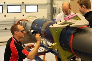 Brad Sharp, Dr Melrose Brown and Dr Michael Creagh from the SCRAMSPACE team work to finalise the payload for the upcoming launch. (Credit: Donald Cook)