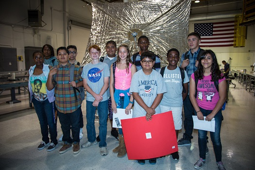 Palm Middle School students stand in front of a model of Sunjammer. (Credit: Sunjammer Mission)