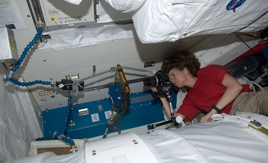 NASA astronaut Catherine Coleman takes a photo of the BCAT-5 hardware setup in the Japanese Kibo Module. (Credit: NASA)