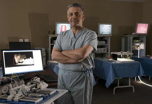 Dr. Mehran Anvari, chief executive officer and scientific director at the Centre for Surgical Invention and Innovation, with the Image-Guided Autonomous Robot (IGAR) manipulator. Image (Credit:  The Hamilton Spectator)