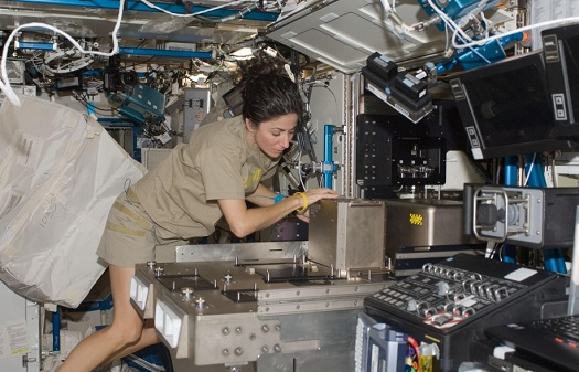 NASA astronaut Nicole Stott installs hardware in the Fluids Integrated Rack (FIR) in the Destiny laboratory of the International Space Station during Expedition 21. (Credit: NASA)