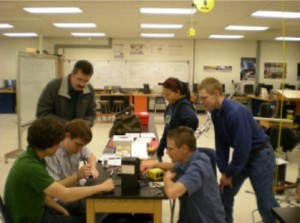 Students assemble the TJ3Sat. (Credit: Orbital Sciences Corporation)