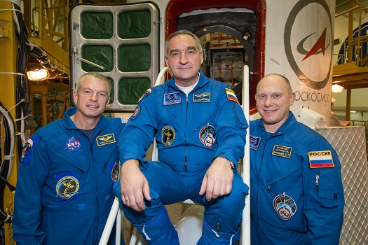 NASA astronaut Steve Swanson (left) and Russian cosmonauts Alexander Skvortsov (center) and Oleg Artemyev of Expedition 39. (Credit:  NASA/Victor Zelentsov)