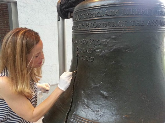 Co-investigator Darlene Cavalier sampling the Liberty Bell for microbes as part of the International Space Station Project MERCCURI investigation. (Credit: National Park Service)
