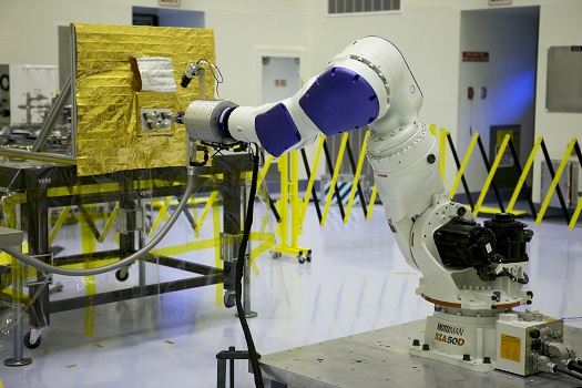 Located at NASA's Kennedy Space Center in Florida, but commanded from NASA's Goddard Space Flight Center in Greenbelt, Md., the RROxiTT industrial robot mimicked how future space robots could transfer oxidizer to a satellite valve (Credit: NASA)