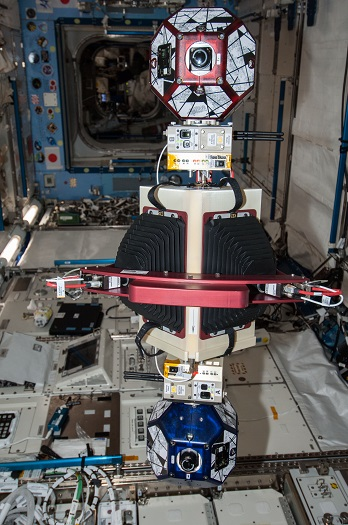 New experiment using the soccer-ball-sized, free-flying satellites known as Synchronized Position Hold, Engage, Reorient, Experimental Satellites, or SPHERES, already on the station, is featured in this image photographed by an Expedition 38 crew member in the ISS. (Credit: NASA)