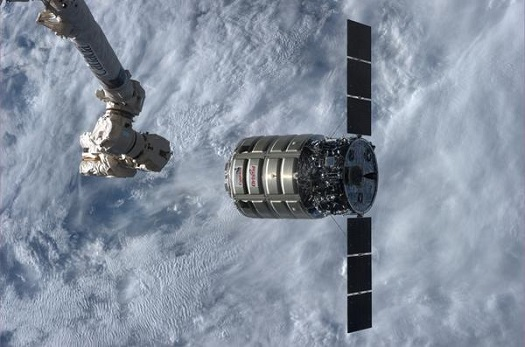 Cygnus and ISS robotic arm (Credit: NASA)