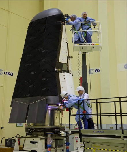 Engineers conduct final tests on ESA's Intermediate eXperimental Vehicle  (IXV). (Credit: ESA)