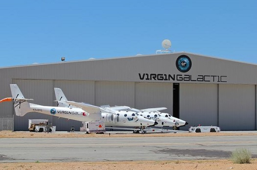 WhiteKnightTwo and SpaceShipTwo on the tarmac on Wednesday, July 23, 2014. (Credit: Virgin Galactic)