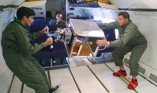 Members of NASA's Jet Propulsion Laboratory team test their grappling tool for small floating objects during a parabolic over-the-top maneuver on NASA's C-9 reduced-gravity aircraft.