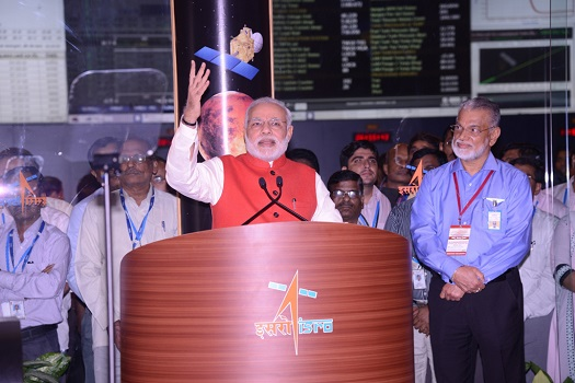 Honourable Prime Minister of India, Mr Narendra Modi, addressing from ISTRAC as ISRO Chairman Dr K Radhakrishnan looks on. (Credit: ISRO)