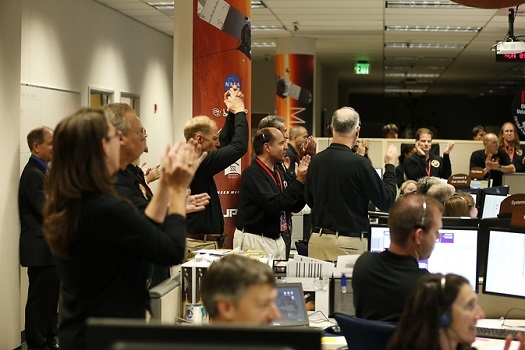 Members of the mission team at the Lockheed Martin Mission Support Area in Littleton, Colorado, celebrate after successfully inserting NASA's Mars Atmosphere and Volatile Evolution (MAVEN) spacecraft into orbit around Mars at 10:24 p.m. EDT Sunday, Sept. 21. (Credit:  Lockheed Martin)