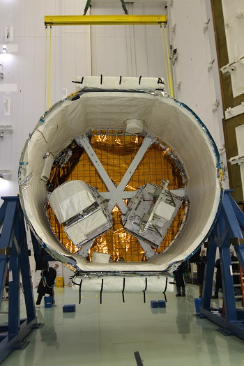 RapidScat's two-part payload is shown in the trunk of a SpaceX Dragon cargo spacecraft at NASA's Kennedy Space Center in Florida. (Credit: NASA)