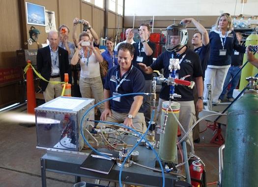 Space Angels trip members watch the firing of an XCOR Lynx thruster. (Credit: Space Angels Network)