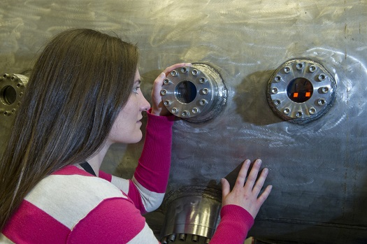 Amy Sivak, an engineer in the Propulsion Research & Technology Branch of the Marshall Center's Engineering Directorate, keeps an eye on NTREES testing in progress. (Credit:  NASA/MSFC/Emmett Given)
