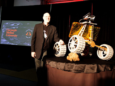 "William ""Red"" Whittaker with Andy the lunar rover. (Credit: CMU)"