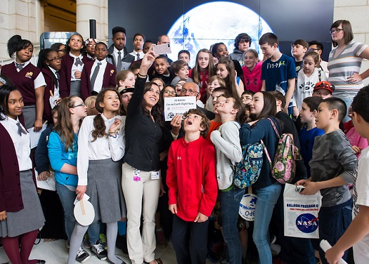 NASA Administrator Charles Bolden poses for a quick selfie with students who attended the NASA-sponsored Earth Day event. (Credit: NASA/Aubrey Gemignani)