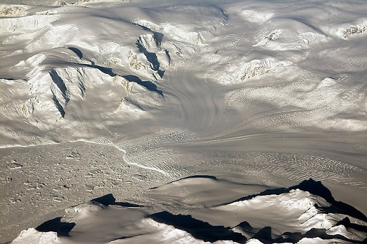 Glaciers and mountains in the evening sun are seen on an Operation IceBridge research flight, returning from West Antarctica. (Credit: NASA/Michael Studinger)