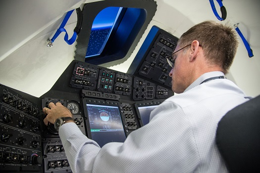 Chris Ferguson of The Boeing Company works through scenarios inside the cockpit simulator of the CST-100 under development. (Credit:  NASA/Bill Stafford)