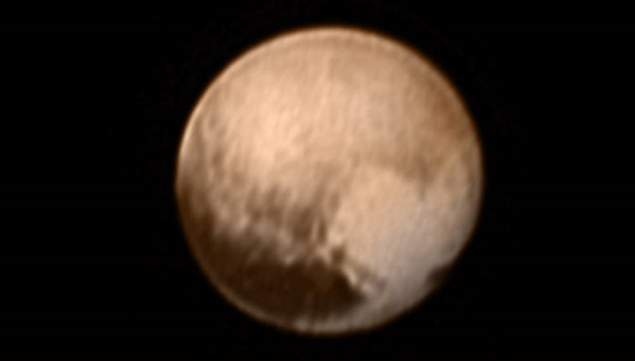 This image of Pluto from New Horizons' Long Range Reconnaissance Imager (LORRI) was received on July 8, and has been combined with lower-resolution color information from the Ralph instrument. (Credits: NASA-JHUAPL-SWRI)